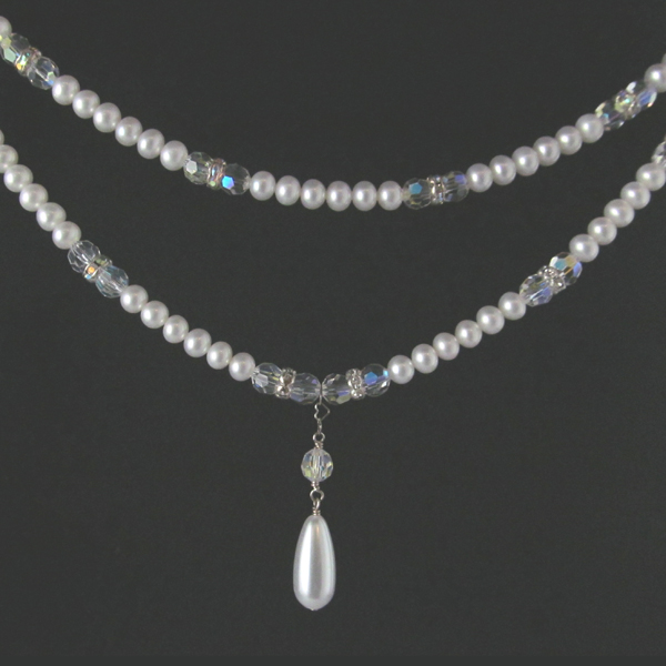 Double strand of pearls and crystals